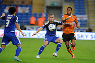 Joe Ralls of Cardiff city holds off Rajiv Van La Parra of Wolves. Skybet football league championship match, Cardiff city v Wolverhampton Wanderers at the Cardiff city stadium in Cardiff, South Wales on Saturday 22nd August 2015.<br /> pic by Andrew Orchard, Andrew Orchard sports photography.