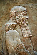 Stone relief sculptured panel of a high dignitary. Facade L. Inv AO 19873-4 from Dur Sharrukin the palace of Assyrian king Sargon II at Khorsabad, 713-706 BC.  Louvre Museum Room 4 , Paris .<br /> <br /> If you prefer to buy from our ALAMY PHOTO LIBRARY  Collection visit : https://www.alamy.com/portfolio/paul-williams-funkystock/ancient-assyria-antiquities.html  Refine search by adding background colour, place, subject, museum etc into the LOWER SEARCH WITHIN GALLERY box to <br /> <br /> Visit our ANCIENT WORLD PHOTO COLLECTIONS for more photos to download or buy as wall art prints https://funkystock.photoshelter.com/gallery-collection/Ancient-World-Art-Antiquities-Historic-Sites-Pictures-Images-of/C00006u26yqSkDOM