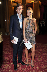 ALEX COLERIDGE and AMBER ATHERTON at a party to celebrate 300 years of Tatler magazine held at Lancaster House, London on 14th October 2009.