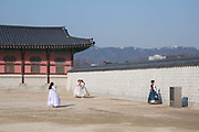 Young Koreans in Hanboks, traditional Korean dress, pose for photos at the Gyeongbokgung Palace on 26th February 2018 in Seoul, South Korea. Gyeongbokgung, also known as Gyeongbokgung Palace or Gyeongbok Palace, was the main royal palace of the Joseon dynasty. Built in 1395, it is located in northern Seoul.