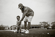 Rep. Cedric Richmond, who represents Louisiana's 2nd Congressional District (which includes most of New Orleans) gives an impromptu lesson to his year-old son, Cedric, at the 10th tee. Photograophed at Joseph M. Bartholomew Sr. Golf Course in New Orleans, LA. March 26, 2016. Photograph © 2016 USGA/Darren Carroll