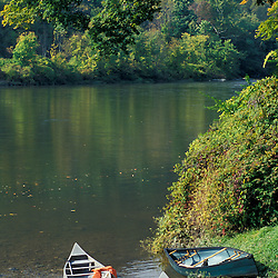 West Cornwall, CT.Canoes sit next to the Housatonic River in the Litchfield Hills of Western Connecticut. Canoes sit next to the Housatonic River in the Litchfield Hills of Western Connecticut. Canoes sit next to the Housatonic River in the Litchfield Hills of Western Connecticut.