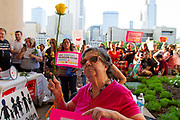 Iris Purron, 82, and who is legally blind, shows her support for the children who were separated from their parents by ICE agents when they crossed the US/Mexico border, during the Families Belong Together protest in front of Dallas City Hall