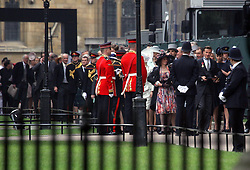 29 April 2011. London, England..Royal wedding day. Celebrity guests arriving at the ceremony included David and Victoria Beckham. (front of line). .Photo; Charlie Varley.