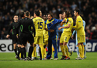 Football - UEFA Champions League - Manchester City vs. Villarreal<br /> Tempers flare at the final whistle as the Villarreal players confront the match officals having lost to an injury time goal at the Etihad Stadium, Manchester