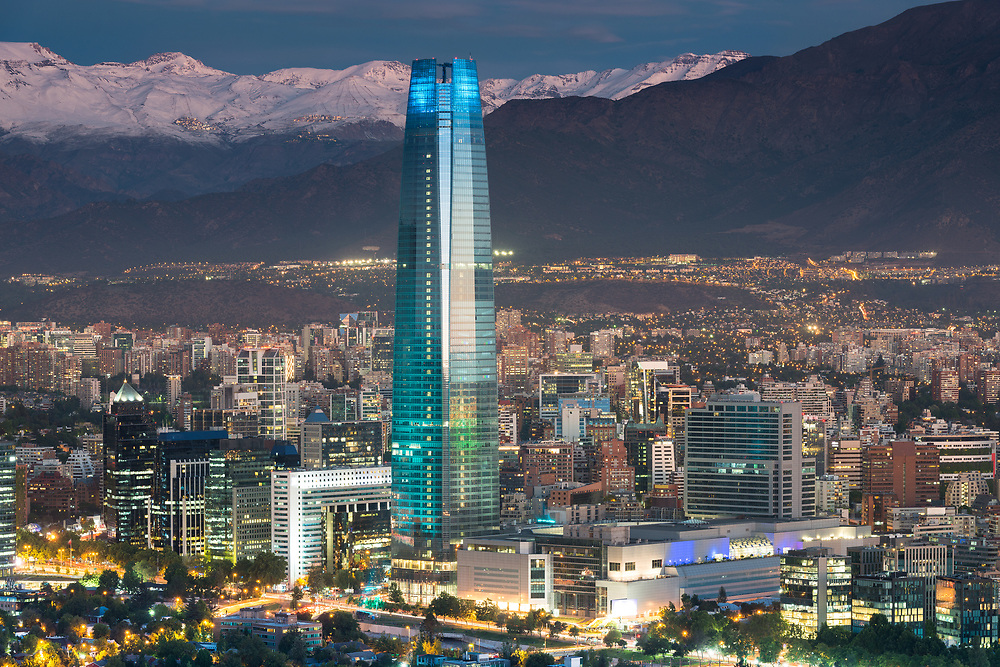 Skyline of Santiago de Chile at the foots of The Andes Mountain Range and buildings at Providencia district.