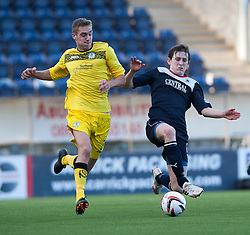 Queen of the South's Kevin Holt and Falkirk's Blair Alston.<br /> Falkirk 2 v 1 Queen of the South, Scottish Championship 5/10/2013.<br /> ©Michael Schofield.