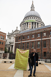 Activists from Africans Rising UK and other groups launch the Jubilee for Climate Campaign in Paternoster Square after a banner is dropped from St Paul's Cathedral on the anniversary of the assassination of the Pan-Africanist President of Burkina Faso Thomas Sankara on 15th October 2021 in London, United Kingdom. The Jubilee for Climate Campaign is an umbrella campaign both for the cancellation of debts for which Sankara fought so hard as well as for progressive and unifying policies to tackle the climate crisis which amplify voices from the Global South.