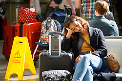© Licensed to London News Pictures. 12/08/2016. London, UK. Eurostar passengers  wait for delayed train services at St Pancras station in London as international rail passengers face a 4 day of travel chaos because of four separate Eurostar strikes in a dispute over members' work-life balance. Photo credit: Tolga Akmen/LNP