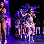 CHARLOTTE, NC: Adriana Blanco, a dancer with the NC Brazilian Arts Project, dances the Samba a few months pregnant at the final Condom Couture Event held in Charlotte, NC on February 9, 2019.