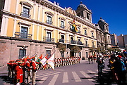 BOLIVIA, LA PAZ raising flag at Presidential Palace