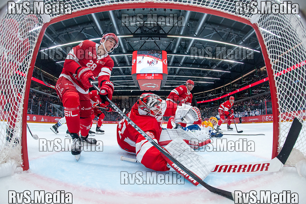 LAUSANNE, SWITZERLAND - OCTOBER 01: Goalie Tobias Stephan #51 of Lausanne HC and Martin Gernat in action during the Swiss National League game between Lausanne HC and ZSC Lions at Vaudoise Arena on October 1, 2021 in Lausanne, Switzerland. (Photo by Monika Majer/RvS.Media)