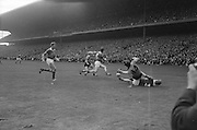 All Ireland Senior Football Championship Final, Kerry v Down, 22.09.1968, 09.22.1968, 22nd September 1968, Down 2-12 Kerry 1-13, Referee M Loftus (Mayo)...P.O'Donoghue (no 3) on the ground Kerry Full back and S. O'Neill (no.14) Down full forward had a collision whhile attempting to get the ball but another Down forward and Kerry back were quick on the scene to take over,..