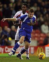 Photo: Paul Thomas.<br /> Stoke City v Cardiff City. Coca Cola Championship. 28/11/2006.<br /> <br /> Cardiff's Paul Parry (Blue) is held back by Salif Diao.