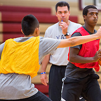 072313       Cable Hoover<br /> <br /> Miki Ippel, right, searches for an open teammate while running offensive drills under the guidance of coach Adrian Pete during the True Hoops basketball camp at Rehoboth High School Tuesday.