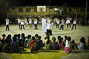 A Saturday night christian show on the baseball court. Nauruans are extremely fervent believers of the Christian faith...Nauru, officially the Republic of Nauru is an island nation in Micronesia in the South Pacific.  Nauru was declared independent in 1968 and it is the world's smallest independent republic, covering just 21 square kilometers..Nauru is a phosphate rock island and its economy depends almost entirely on the phosphate deposits that originate from the droppings of sea birds. Following its exploitation it briefly boasted the highest per-capita income enjoyed by any sovereign state in the world during the late 1960s and early 1970s..In the 1990s, when the phosphate reserves were partly exhausted the government resorted to unusual measures. Nauru briefly became a tax haven and illegal money laundering centre. From 2001 to 2008, it accepted aid from the Australian government in exchange for housing a Nauru detention centre, with refugees from various countries including Afghanistan and Iraq..Most necessities are imported on the island..Nauru has parliamentary system of government. It had 17 changes of administration between 1989 and 2003. In December 2007, former weight lifting medallist Marcus Stephen became the President.