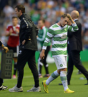 06/08/14 UEFA CHAMPIONS LEAGUE 3RD QUALIFYING RND 2ND LEG<br /> CELTIC v LEGIA WARSAW<br /> BT MURRAYFIELD STADIUM - EDINBURGH<br /> Kris Commons (right) walks past Celtic manager Ronny Deila after being substituted