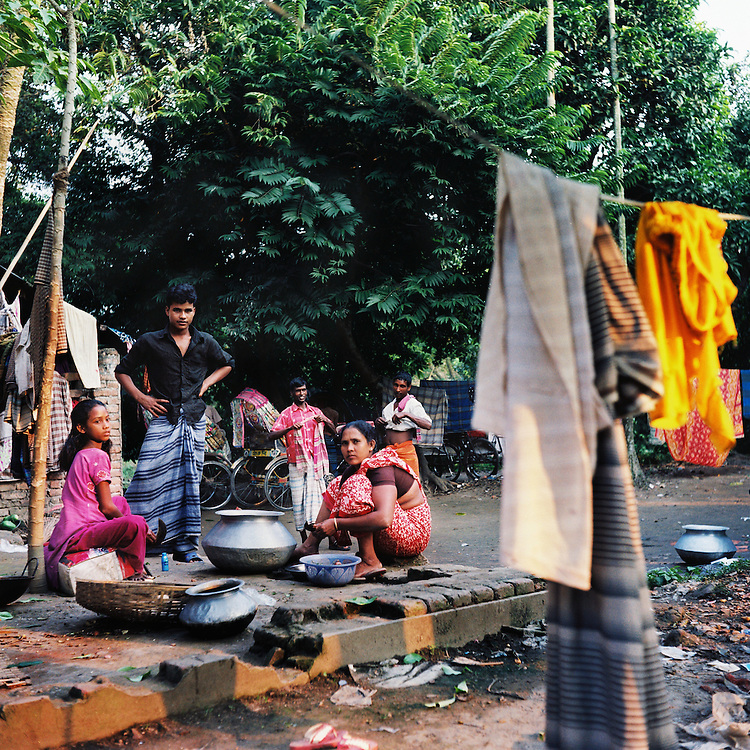 Children playing in the streets of Sonargon, the ancient capital of Bengal. Sonargon, though long run-down and mostly abandoned, serves as a key site of Bengali cultural heritage. It also was used as a shelter for thousands during the war.<br /> <br /> Sonargon, Bangladesh. November 2010.