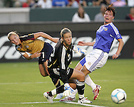 25 August 2007: United States midfielder Lori Chalupny (17) threads the needle between Finland goalkeeper Tinja-Riikka Korpela (12) and defender Sanna Valkonen (right) to assist on a goal by US teammate Kristine Lilly (not pictured). The United States Women's National Team defeated the Women's National Team of Finland 4-0 at the Home Depot Center in Carson, California in an International Friendly soccer match.