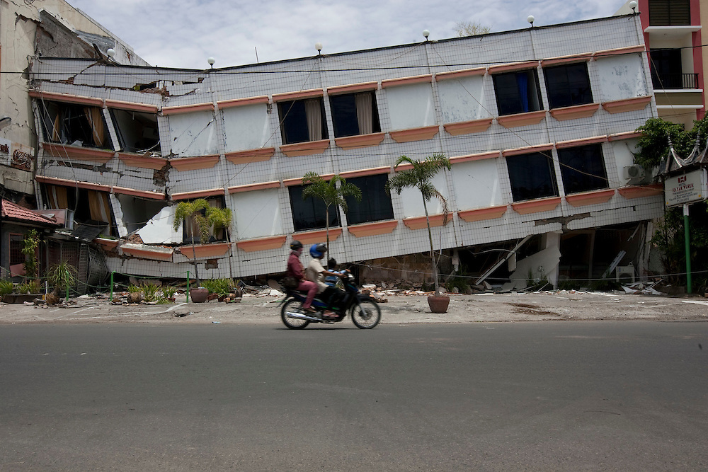 Padang, Western Sumatra, Indonesia, 7th October 2009:?A motorcycle rides by an earthquake affected building in Hayam Wuruk Street in Padang following a devastating earthquake in Western Sumatra that claimed the lives of an estimated 2000 people.?Photo: Joseph Feil
