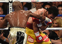 May 2.2015. Las Vegas NV. ( in Gld-blk color trunks) Floyd Mayweather Jr. goes 12 rounds with Manny Pacquiao Saturday at the MGM Grand Hotel. Floyd Mayweather Jr. took the win by  unanimous decision over Manny Pacquiao in Las Vegas.<br /> Photo by Gene Blevins/LA Daily News