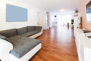 Spacious living room with large sofa. Very intimate and welcoming apartment
