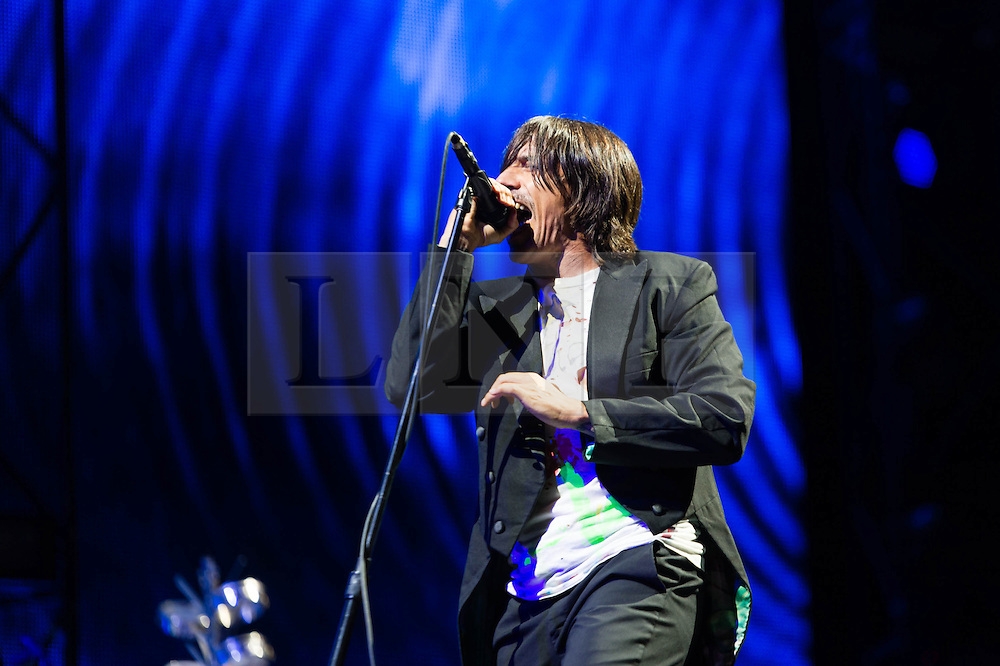 """© Licensed to London News Pictures. 14/06/2014. Isle of Wight, UK.   Red Hot Chili Peppers performing live at Isle of Wight Festival .   In this picture - Anthony Kiedis.  Red Hot Chili Peppers are an American rock band composed of members Anthony Kiedis (lead vocals),Michael """"Flea"""" Balzary  (bass), Chad Smith (drums), Josh Klinghoffer (guitar, keyboards, backing vocals).   Isle of Wight festival is an annual music festival that takes place on the Isle of Wight. Photo credit : Richard Isaac/LNP"""