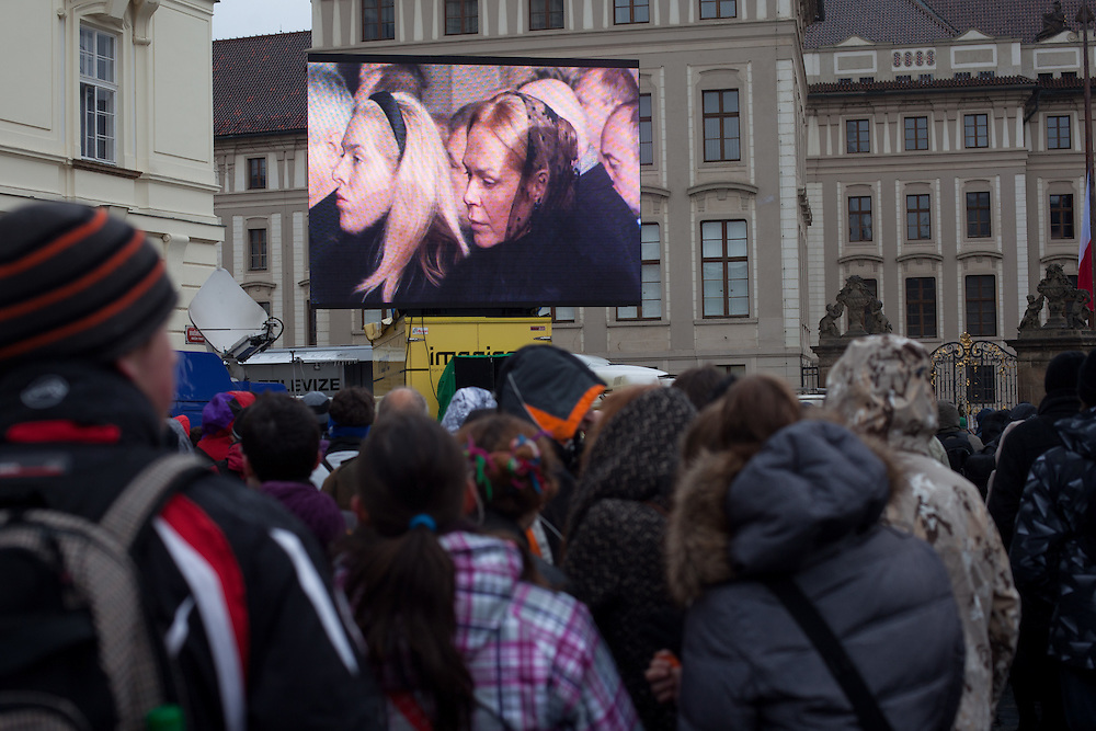 About 10000 Czech citizens accompanied the remains of Vaclav Havel from the Old Town part in Prague across Charles Bridge   up to Prague Castle, the seat of Czech presidents. People are watching on a big screen projection the mourning ceremony  for former President Vaclav Havel at Prague Castle. Pictured  Vaclav Havel's wife Dagmar Havlova and her daughter Nina (left).