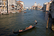 Empty gondola on Venice's Grand Canal seen from Ponte Accademia.