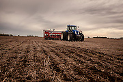 2014/11/20 – Monte Maiz, Argentina: 22 million hectares of land were planted this year in Argentina with soy. These are two-thirds of the available arable land. A tractor pulls a seeding machine that is dropping soy seeds on a field in the Monte Maiz region. Only one tractor can seed 100 hectares on a single day. Production is almost completely automatized and in many cases with the right machines only one man is needed to do all the work, creating massive unemployment in the area. (Eduardo Leal)