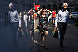 © Licensed to London News Pictures. 29/06/2018. LONDON, UK.  Commuters and tourists walk down Regent Street during rush hour in the bright sunshine.  The forecast is for warm temperatures to continue for the next few days.  Photo credit: Stephen Chung/LNP