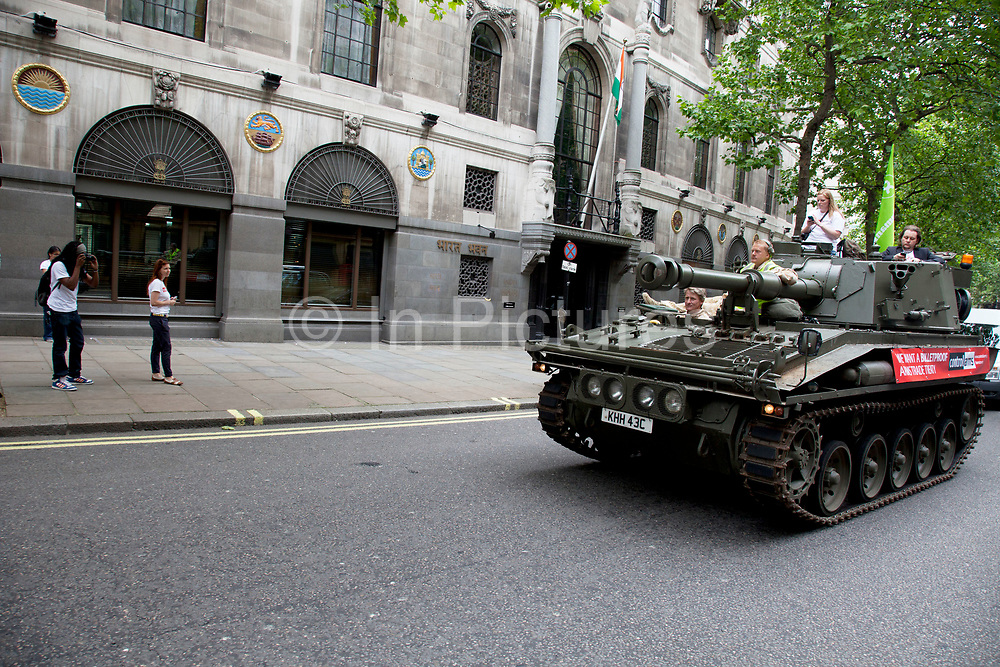 Tank passes the High Commission of India. Campaigners and supporters from Oxfam and Amnesty International, as part of the Control Arms coalition, drive an Abbot gun tank around central London to highlight the need for a global Arms Trade Treaty (ATT) to be agreed during a United Nations conference next month (July 2012). London, England, UK. 27th June 2012.