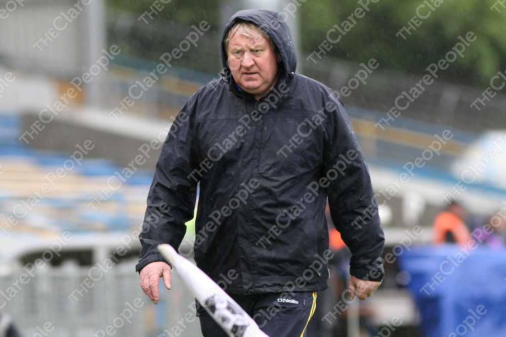 Clare Intermediate team manager Kevin Kennedy walks the line during the Munster Intermediate Hurling Semi-Final. - Photograph by Flann Howard
