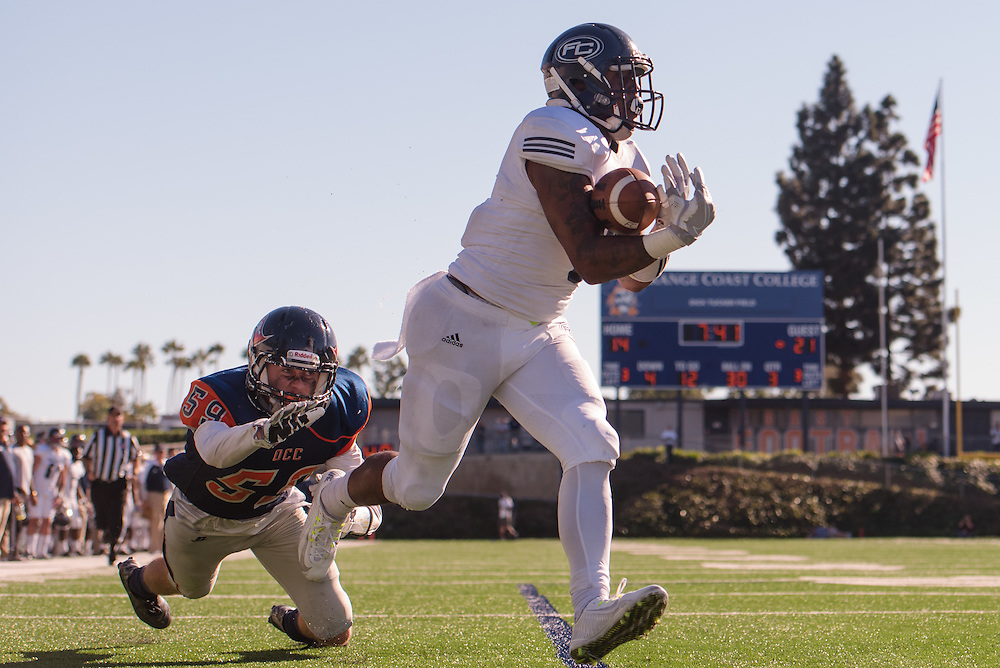 11/5/163:04:43 PM --- Football --- Fullerton College running back Phillip Butler (6) catches a touchdown pass as Orange Coast College's Bryce Garcia (59) tries to defend him during a game at LeBard Stadium in Costa Mesa, CA.<br /> <br /> Photo by Brian Rothmuller, Sports Shooter Academy