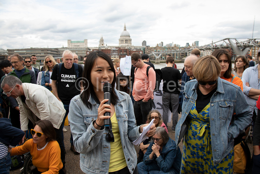 Tania Han, Climate Reality Leader, The Climate Reality Project UK speaks at the Rise For Climate Change event held outside Tate Modern in London, England, United Kingdom on September 8th 2018. Tens of thousands of people joined over 830 actions in 91 countries under the banner of Rise for Climate to demonstrate the urgency of the climate crisis. Communities around the world shined a spotlight on the increasing impacts they are experiencing and demanded local action to keep fossil fuels in the ground. There were hundreds of creative events and actions that challenged fossil fuels and called for a swift and just transition to 100% renewable energy for all. Event organizers emphasized community-led solutions, starting in places most impacted by pollution and climate change. Photographed for 350.org.