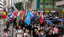 Hong Kong. 1 October 2019. Peaceful march of estimated 100,000 marchers from Causeway Bay to Central passed without trouble. Activists provoked police in the afternoon and this led to violence at various parts of the city.  Iain Masterton/Alamy Live News.
