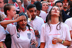 © Licensed to London News Pictures. 11/07/2018. London, UK. England fans in Flat Iron Square, London, react as Croatia score the equaliser as they watch England play Croatia in the World Cup semi-final. Photo credit: Rob Pinney/LNP
