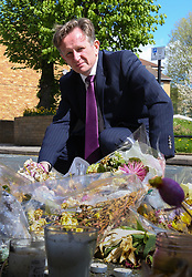 Senior investigating officer Detective Chief Inspector Noel McHugh looks at the flowers marking the spot where Abraham Badru was shot. Abraham Badru, a personal trainer, 26, was shot in the chest on 25th March in Ferncliff Road, E8. He received a National Police Bravery Award after intervening in a rape and giving evidence in court. London, April 25 2018.