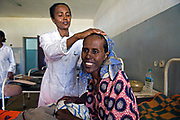 A nurse helps an AIDS patient at the Hospital in Addis Ababa, Ethiopia. Globally, there were an estimated 17.3 million women living with HIV in 2005 – three quarters (or 13.2 million) were living in sub-Saharan Africa.