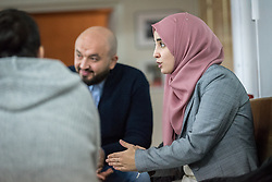 1 December 2019, Madrid, Spain: Muslim woman Hana Elabdallaoui moderates a group discussion as representatives of various faiths gather in the Iglesia de Jesús (Church of Christ) of the Iglesia Evangélica Española (Evangelical Church of Spain) for an interfaith dialogue and prayer service on the eve of the United Nations climate conference (COP25) in Madrid, Spain.