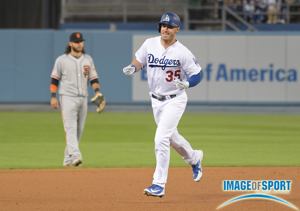 Apr 1, 2018; Los Angeles, CA, USA; Los Angeles Dodgers first baseman Cody Bellinger (35) celebrates after hitting a two-run home run in the sixth inning against the San Francisco Giants during a MLB baseball game at Dodger Stadium.
