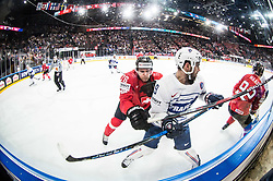Joel Genazzi of Switzerland vs Damien Fleury of France during the 2017 IIHF Men's World Championship group B Ice hockey match between National Teams of Switzerland and France, on May 9, 2017 in Accorhotels Arena in Paris, France. Photo by Vid Ponikvar / Sportida
