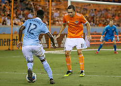 August 4, 2018 - Houston, TX, U.S. - HOUSTON, TX - AUGUST 04:  Houston Dynamo forward Andrew Wenger (11) approaches to challenge Sporting Kansas City forward Gerso (12) during the soccer match between Sporting Kansas City and Houston Dynamo on August 4, 2018 at BBVA Compass Stadium in Houston, Texas.  (Photo by Leslie Plaza Johnson/Icon Sportswire) (Credit Image: © Leslie Plaza Johnson/Icon SMI via ZUMA Press)