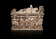 """Roman relief sculpted sarcophagus of Domitias Julianus and Domita Philiska depicted reclining on the lid, 2nd century AD, Perge. Antalya Archaeology Museum, Turkey.. Against a black background.<br /> <br /> it is from the group of tombs classified as. """"Columned Sarcophagi of Asia Minor"""". <br /> The lid of the sarcophagus is sculpted into the form of a """"Kline"""" style Roman couch on which lie Julianus &  Philiska. This type of Sarcophagus is also known as a Sydemara Type of Tomb.<br /> <br /> If you prefer to buy from our ALAMY STOCK LIBRARY page at https://www.alamy.com/portfolio/paul-williams-funkystock/greco-roman-sculptures.html . Type -    Antalya    - into LOWER SEARCH WITHIN GALLERY box - Refine search by adding a subject, place, background colour, etc.<br /> <br /> Visit our ROMAN WORLD PHOTO COLLECTIONS for more photos to download or buy as wall art prints https://funkystock.photoshelter.com/gallery-collection/The-Romans-Art-Artefacts-Antiquities-Historic-Sites-Pictures-Images/C0000r2uLJJo9_s0"""