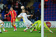 Craig Bellamy of Wales has a shot at goal.  FIFA World cup 2014 qualifying match, Wales v Macedonia at the Cardiff city stadium in Cardiff on Friday 11th October 2013 pic by Andrew Orchard, Andrew Orchard sports photography,