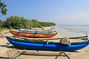 Outrigger fishing canoes on tropical beach at Pasikudah Bay, Eastern Province, Sri Lanka, Asia
