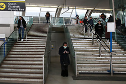 © Licensed to London News Pictures. 15/03/2020. London, UK. A woman wearing a face mask at Stratford station amid an increased number of coronavirus (COVID-19) cases in the UK. 21coronavirus victims have died and 820 cases have tested positive of the virus in the UK of which 167 in London. Photo credit: Dinendra Haria/LNP