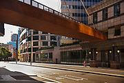 New rusty steel bridge raised walkway at the London Wall Place development, City of London, during the coronavirus pandemic on the 2nd May 2020 in London, United Kingdom.
