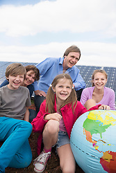 Photovoltaic green energy family sitting happy
