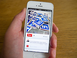 Linked-in on Pintrest social media and photo sharing app on  white iPhone 5 smartphone white iPhone 5 smartphone